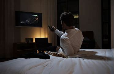 man watching tv in hotel