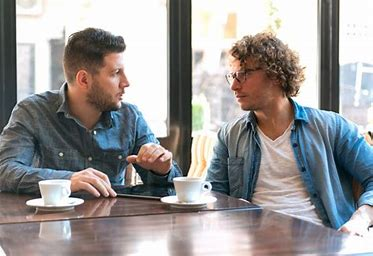 two men having coffee